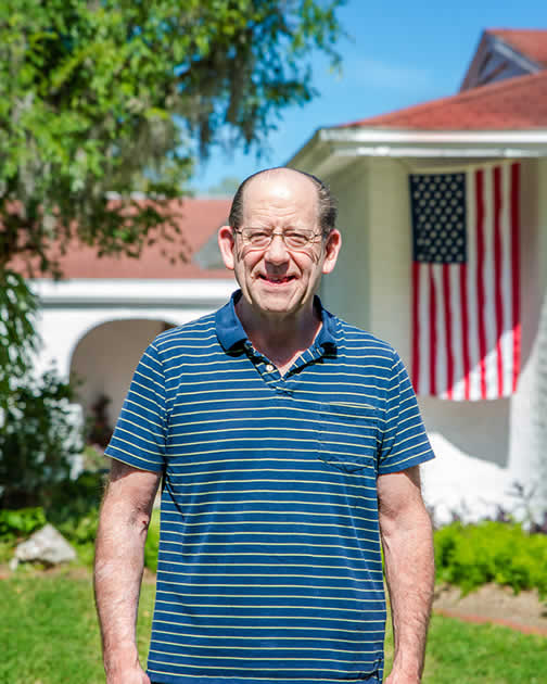 Major Joseph Brod, USAF, Retired proudly standing in front of his home in Brandon, FL