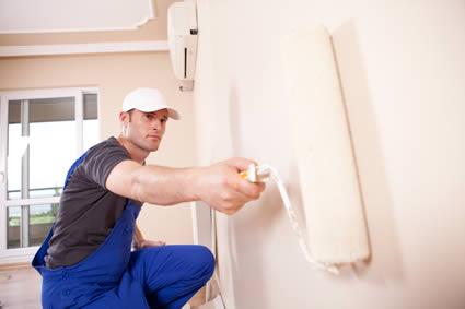 man repainting interior room